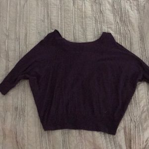 Cute sweater with open back .